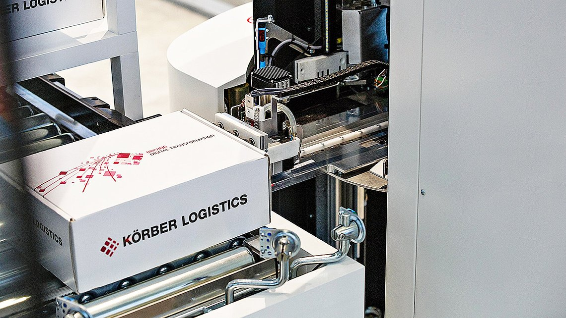 Photo of the picking robot Toru grasping a box using its suction unit